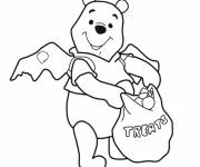 Coloring pages Winnie the Pooh happy with his harvest at Halloween