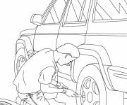 Coloring pages Mechanic changes the wheel of a car