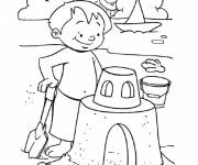 Free coloring and drawings Child builds his Sand Castle Coloring page