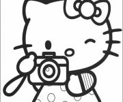 Coloring pages Hello Kitty takes a photo