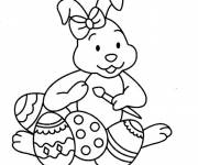 Coloring pages Cute bunny decorating Easter eggs