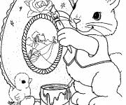 Coloring pages Easter bunny draws a beautiful picture