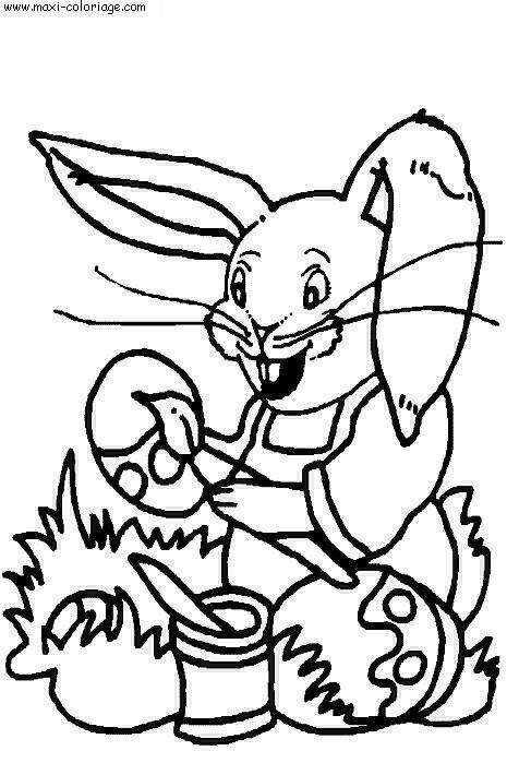 Free coloring and drawings Funny rabbit decorates eggs Coloring page
