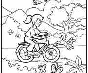 Coloring pages Girl has fun on her bike in nature